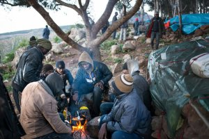 African migrants camp out in the hills of Morocco near the Spanish enclave of Melilla. Credit Samuel Aranda for The New York Times (Feb 27, 2014)
